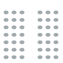 Multiple chairs placed conference-style with central aisle in between the two sections
